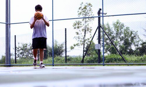 man-holding-orange-basketball-1425673